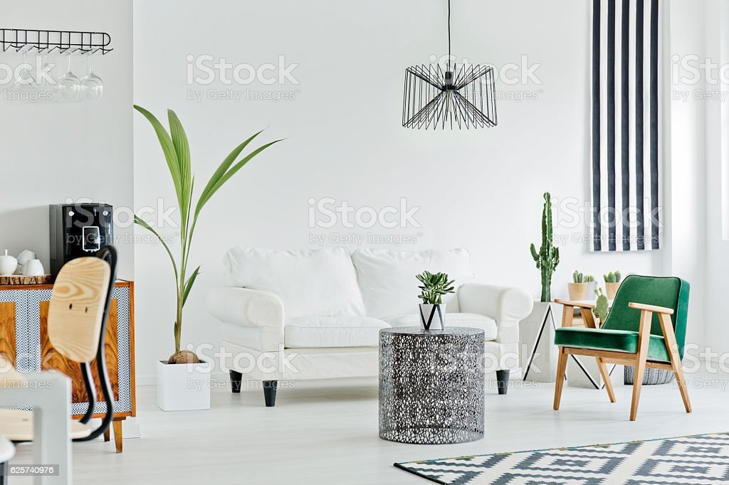 Multifunctional interior with white sofa stock photo