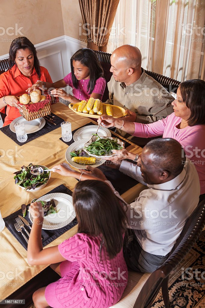 Multi-generation African American family at dinner table stock photo