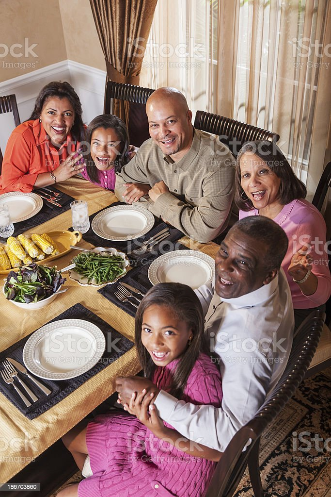 Multi-generation African American family dinner gathering stock photo