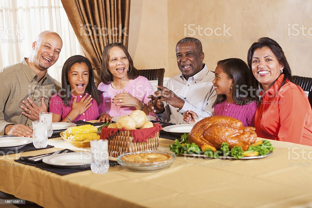 Multi-generation African American family gathering for holiday meal royalty-free stock photo