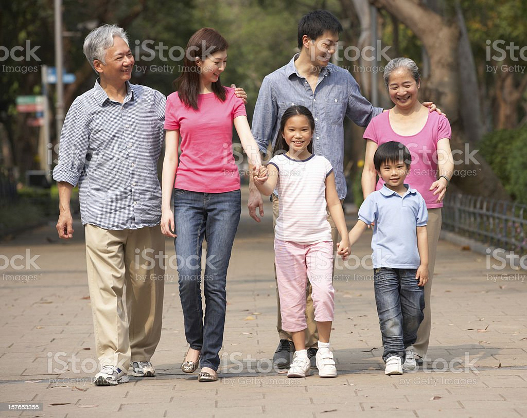 Multi-generation Chinese family walking in a park royalty-free stock photo