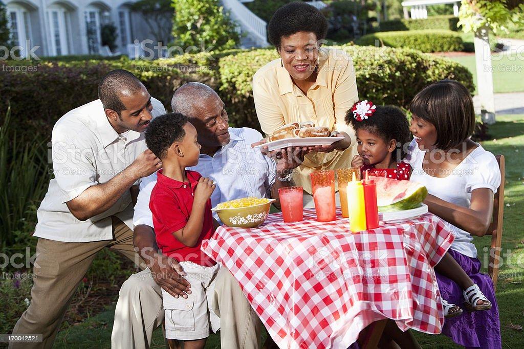 Multi-generation family at picnic table royalty-free stock photo