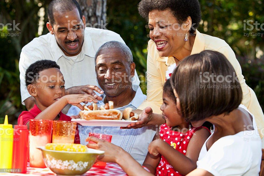 Multi-generation family at picnic table stock photo