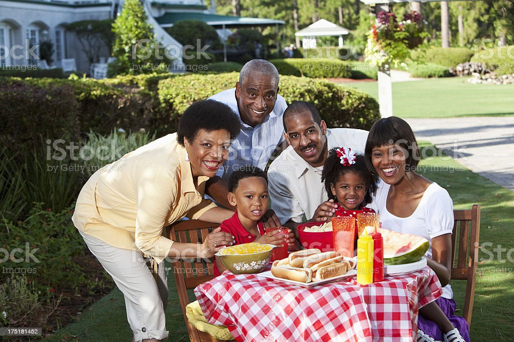 Multi-generation family at picnic table royalty-free stock photo