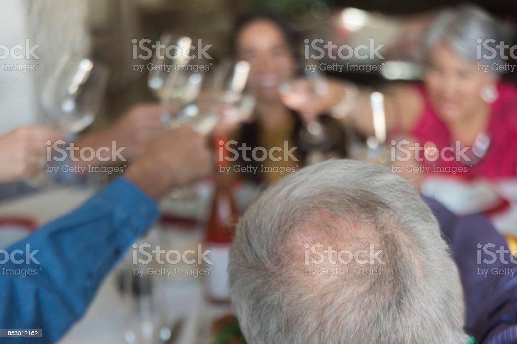 Multi-generation family celebrating with a toast stock photo