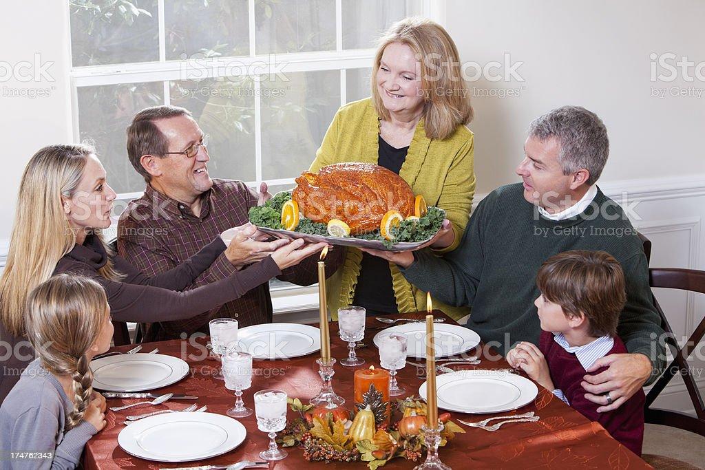Multi-generation family enjoying traditional holiday dinner royalty-free stock photo