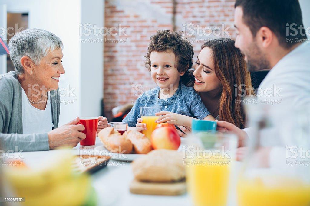 Multi-generation family having breakfast stock photo