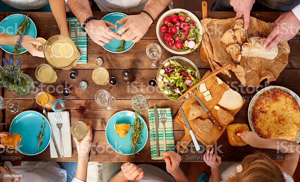 Multi-generation family meal stock photo