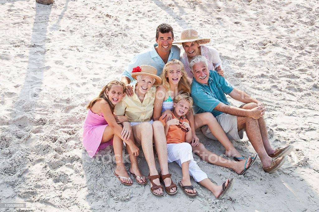 Multi-generation family on beach stock photo