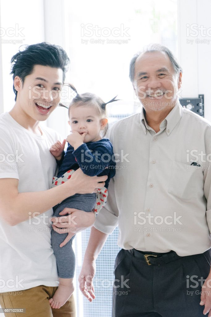 Multi-generation family portrait indoors stock photo