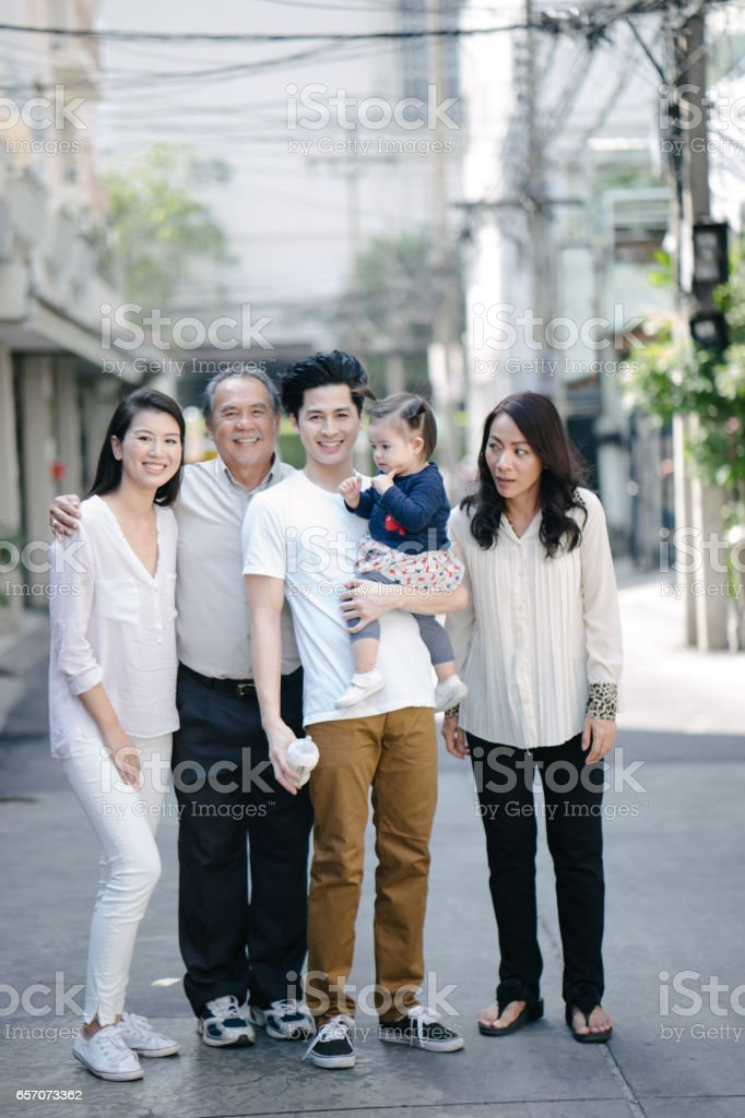 Multi-generation family portrait outdoors stock photo