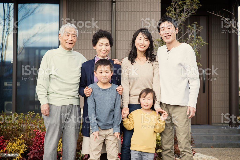 Multi-generation Family standing in front of my home stock photo