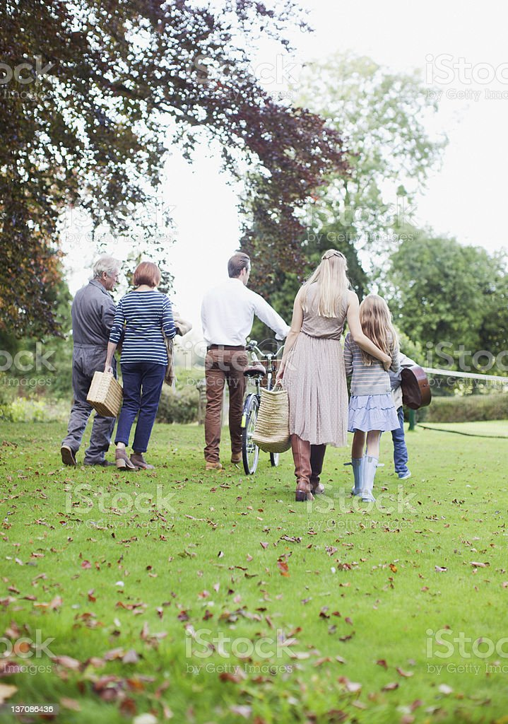 Multi-generation family walking in park royalty-free stock photo