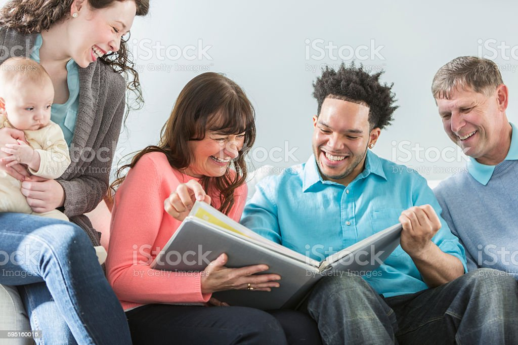 Multi-generation, multi-ethnic family, photo album stock photo