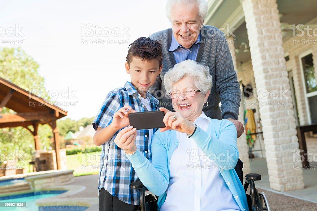 Multigenerational family pose for selfie stock photo