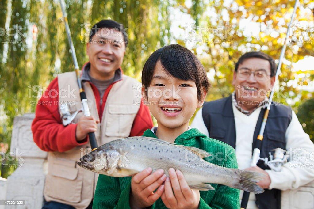 Multi-generational men fishing portrait stock photo