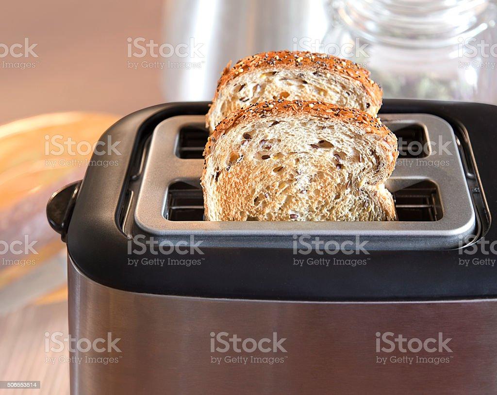 Multi-grain bread in toaster stock photo