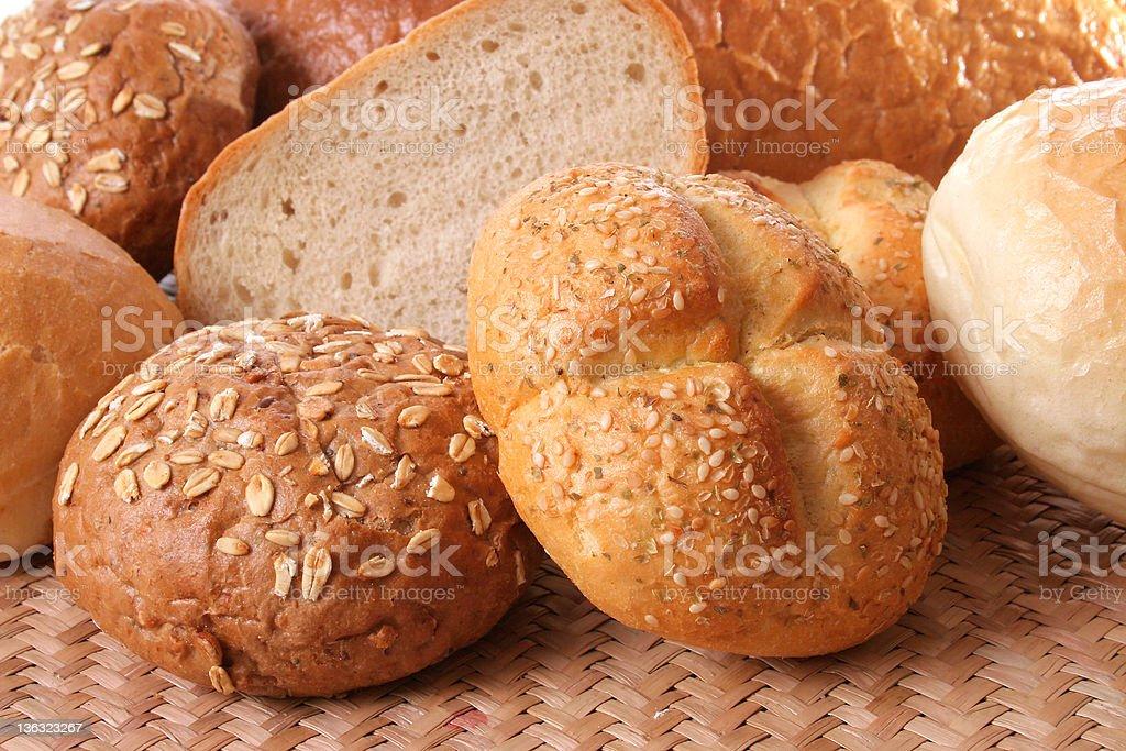 Multigrain bread rolls on woven may royalty-free stock photo