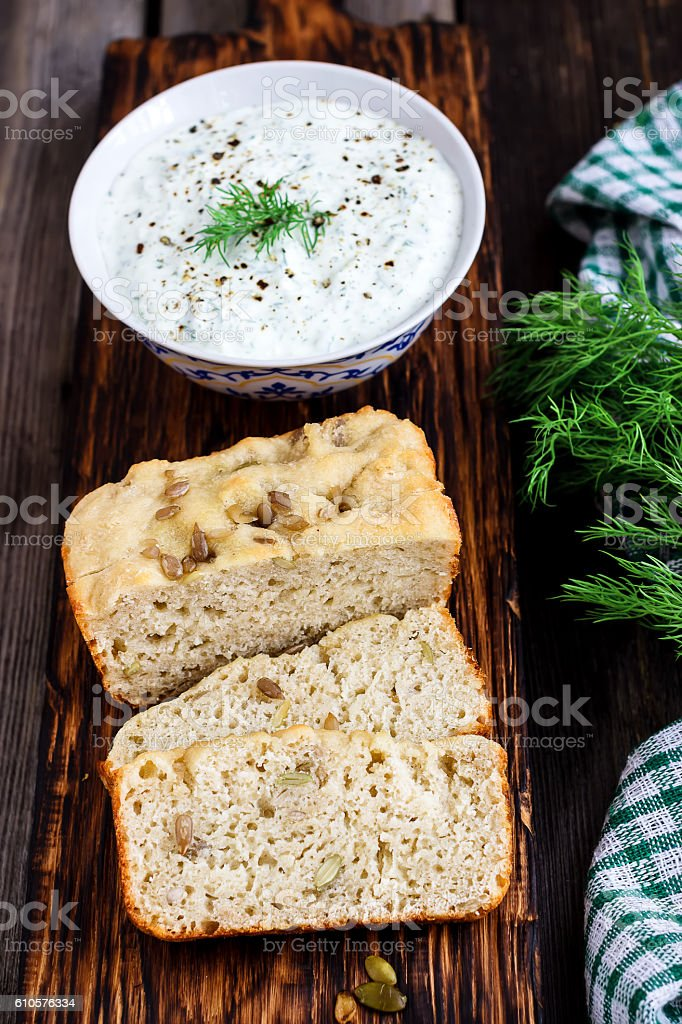 Multigrain bread,dill  and spiced yoghurt on rustic background. stock photo