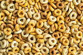 Multigrain cereals in a form of rings, close-up, food background