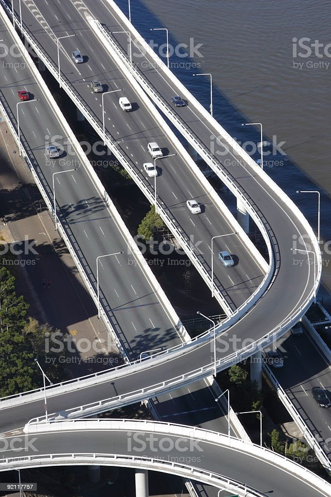 Multi-lane freeway next to a body of water royalty-free stock photo