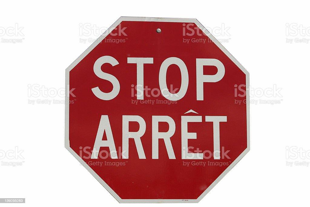 Multilingual Stop Sign Arret stock photo