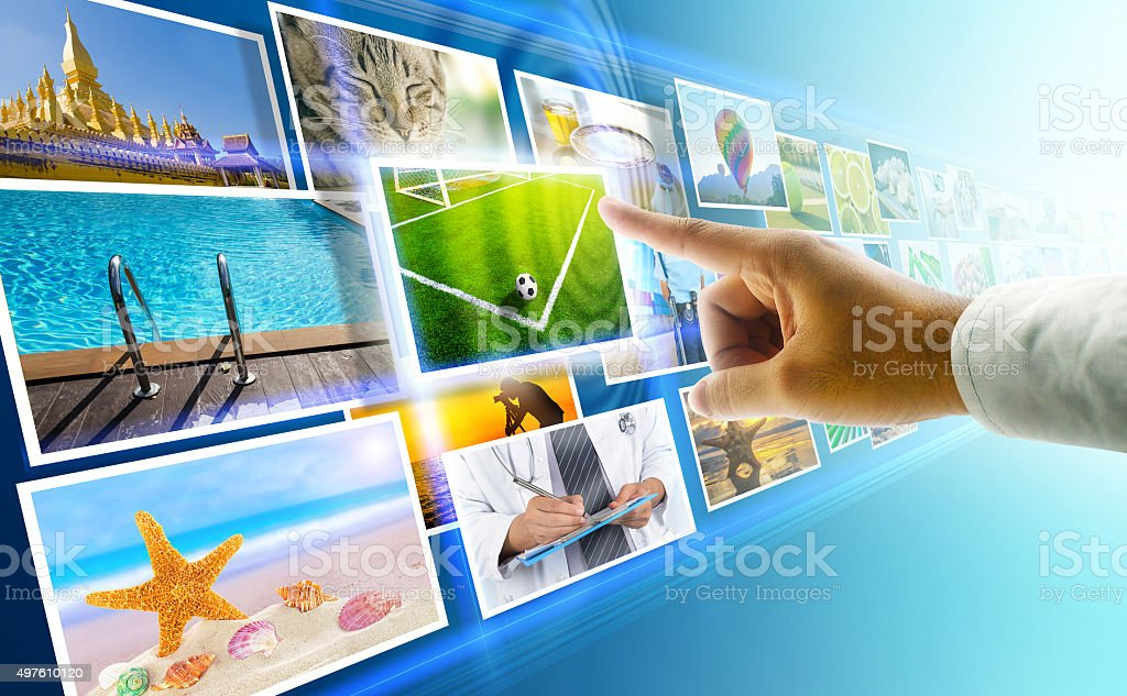 Multimedia touch with hand stock photo