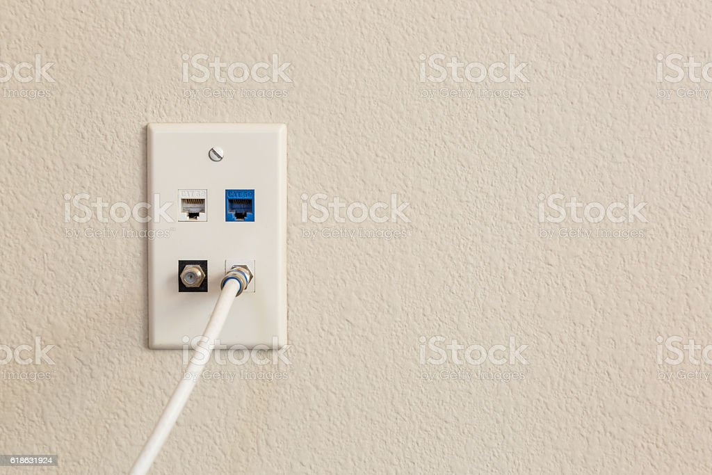 Multi-media Wall Plate with Cable stock photo
