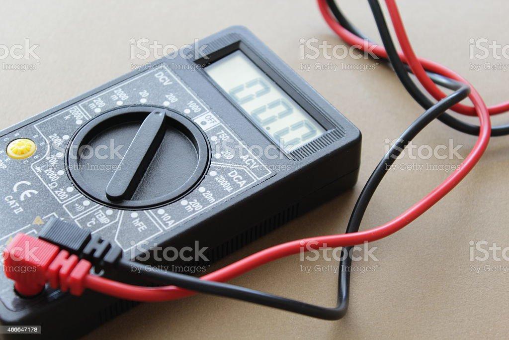 Multimeter on light brown background stock photo