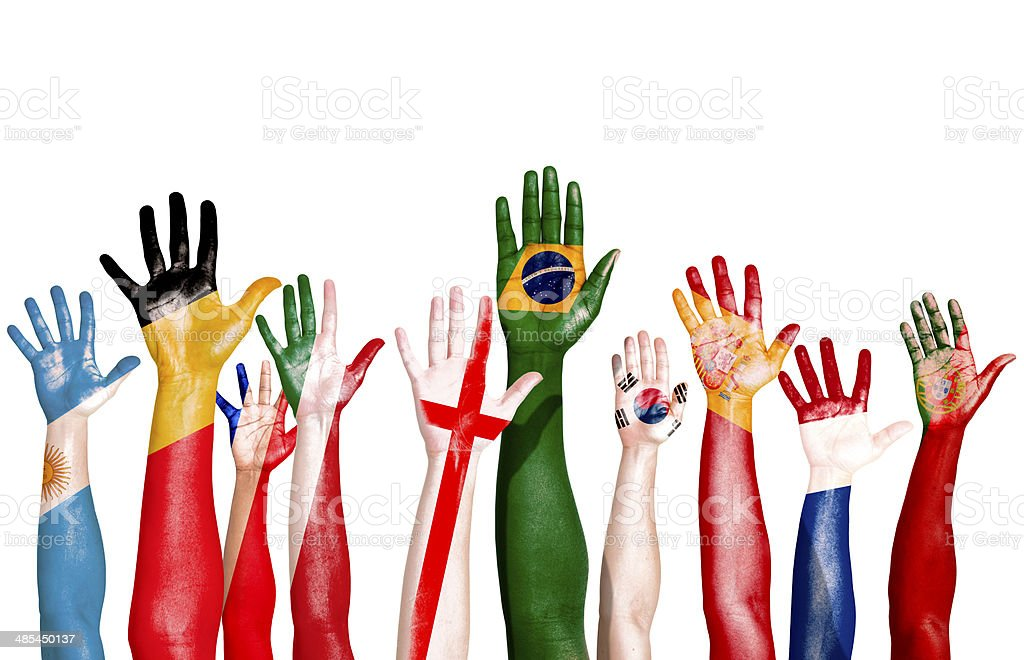 Multi-National Flags Drawn on Raised Hands stock photo