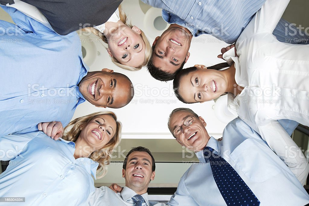 Multinational group of business people with their heads together royalty-free stock photo