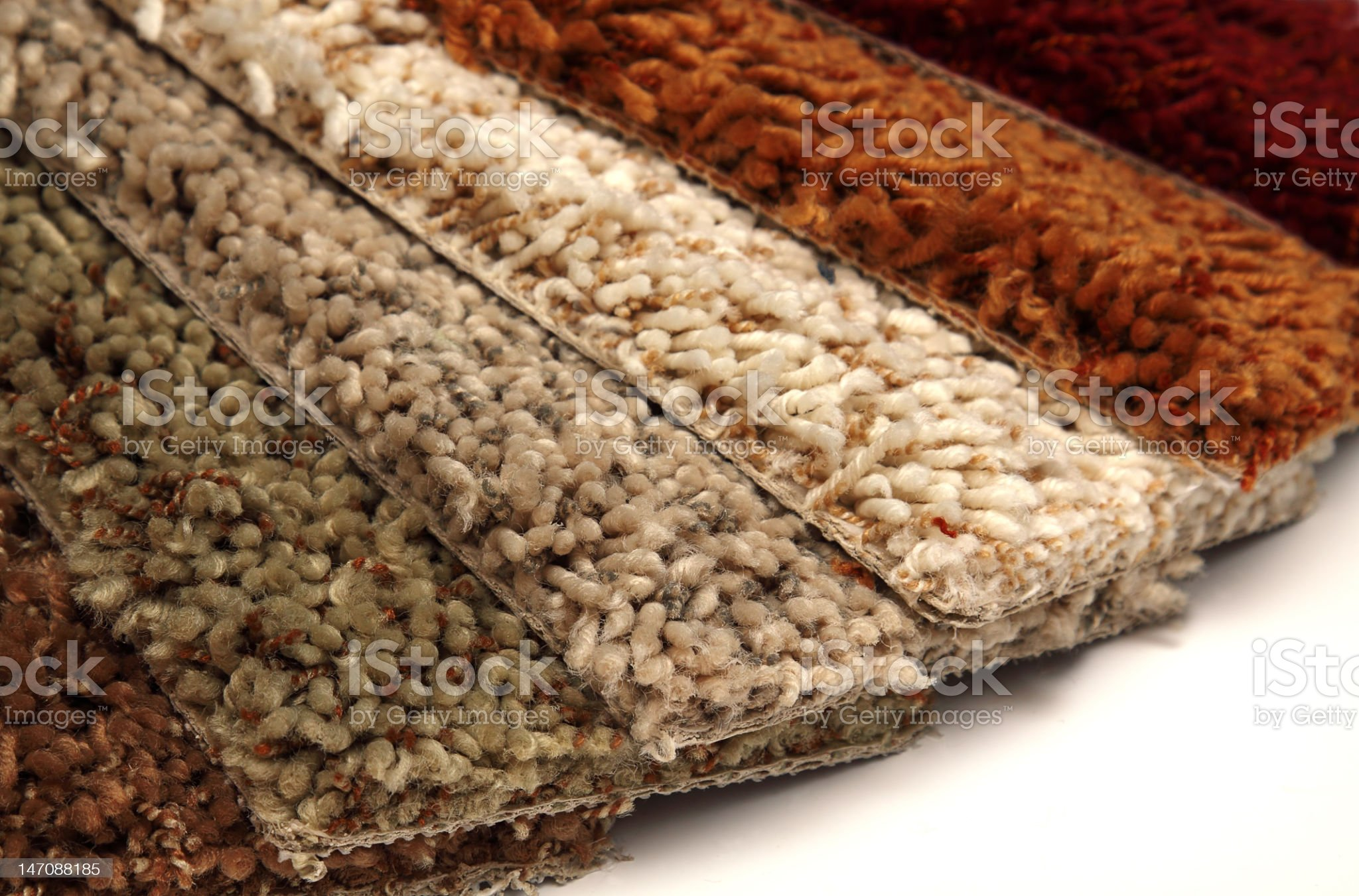 Multiple carpet coverings on a white background royalty-free stock photo
