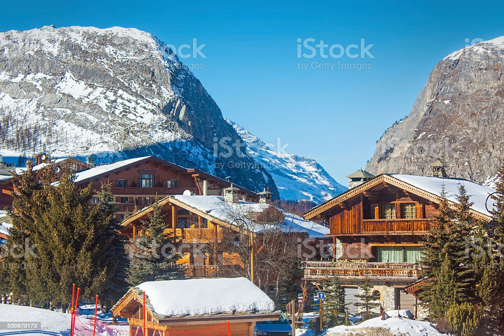 Multiple chalet in Alps mountain in winter stock photo