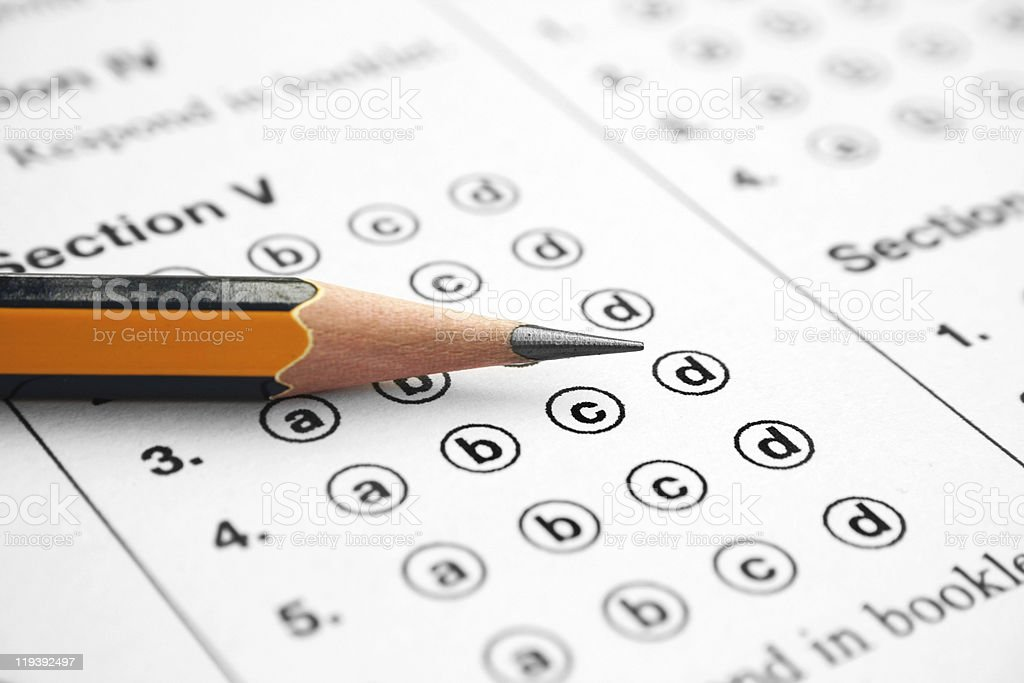Multiple choice test answer sheet with sharpened pencil stock photo
