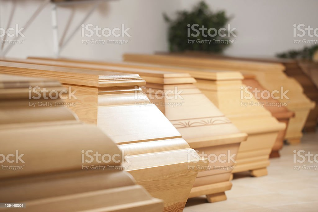 Multiple coffins for sale in a row stock photo