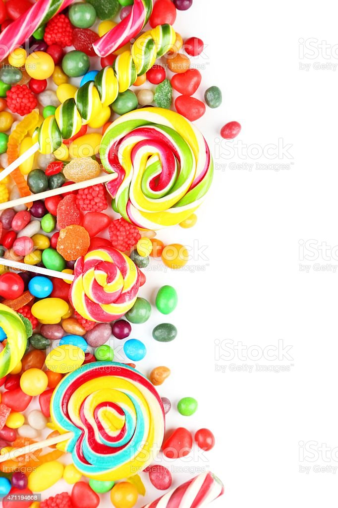 Multiple colorful fruit candies on white background stock photo