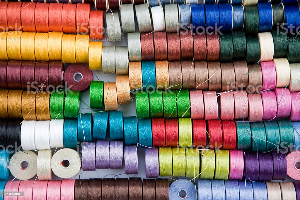 Multiple colors of thread on spools royalty-free stock photo