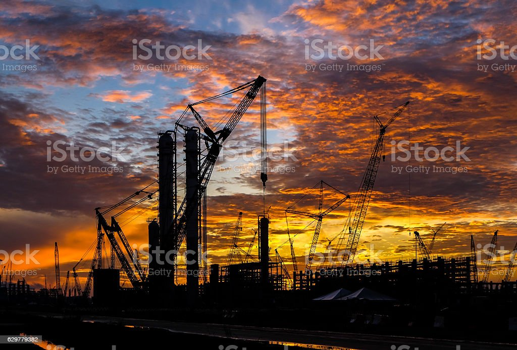 Multiple cranes in construction sites. stock photo
