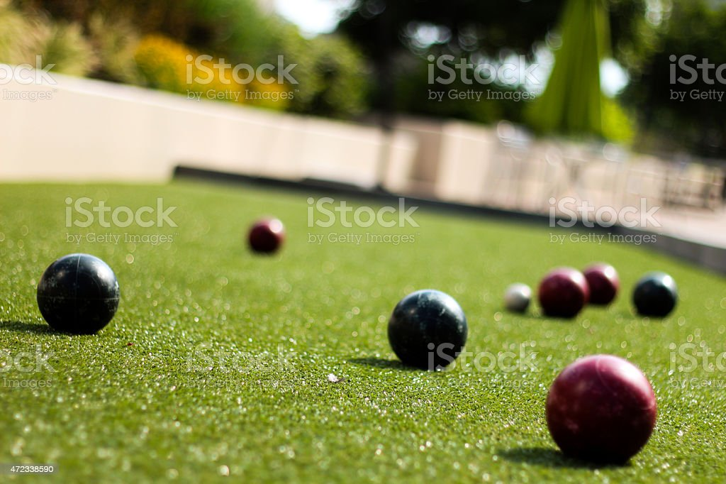 Multiple Croquet Balls on Green stock photo