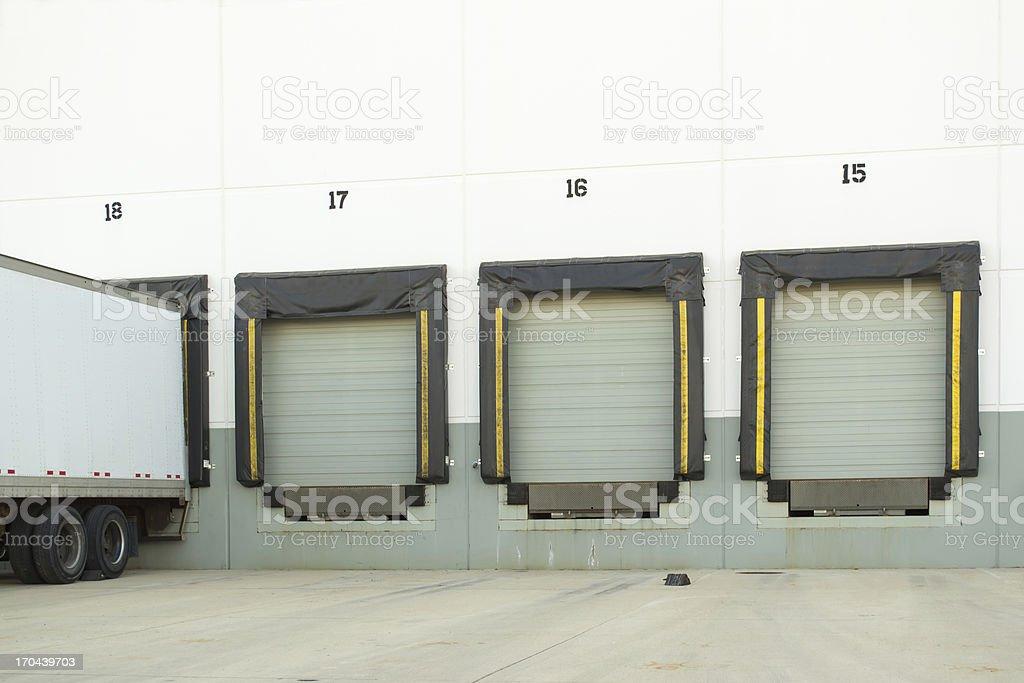 Multiple dock doors with truck stock photo