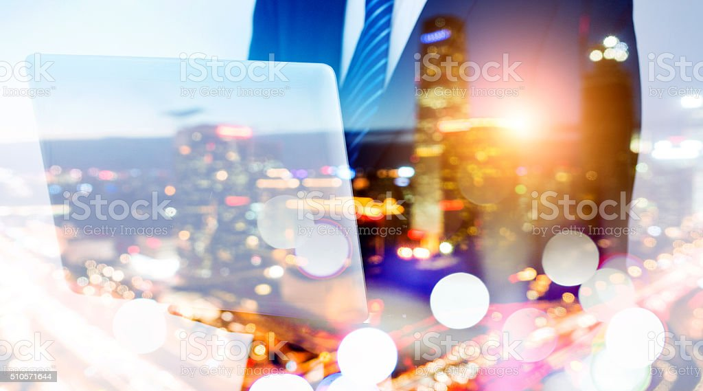 Multiple exposure businessman using laptop stock photo