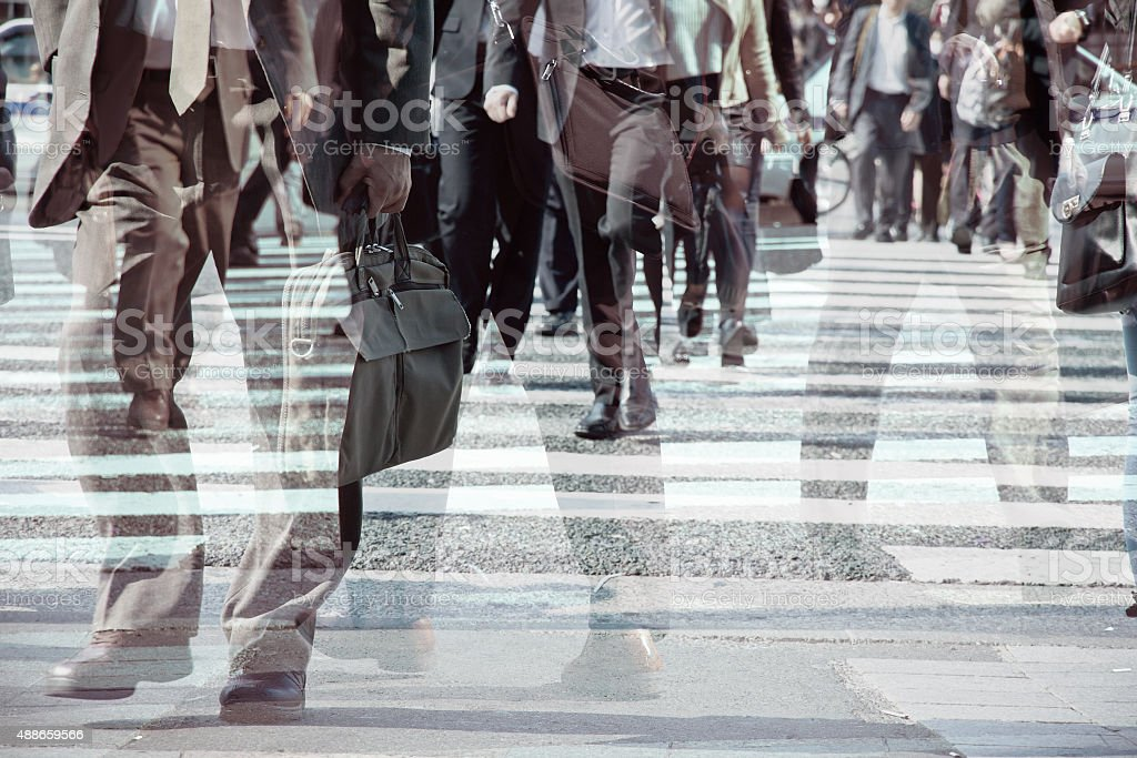 Multiple exposure image of businessman walking stock photo