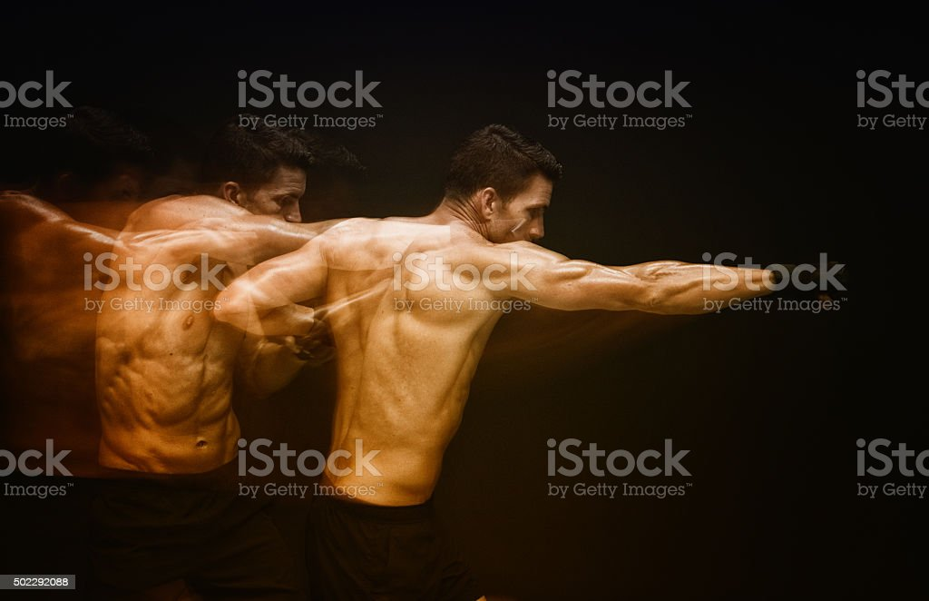 Multiple Exposure - Muscular fighter punching stock photo