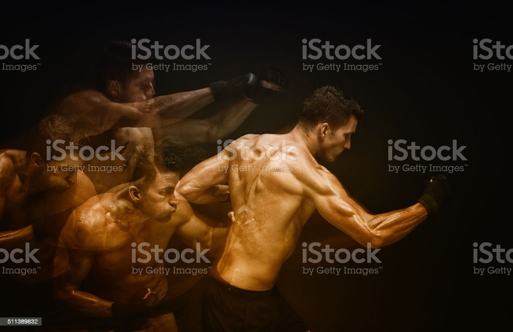 Multiple Exposure - Muscular man in combat pose stock photo
