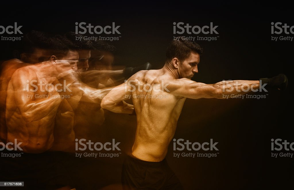 Multiple Exposure - Muscular man punching stock photo
