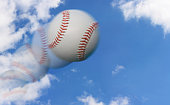 Multiple Exposure of a Baseball Flying Through the Sky