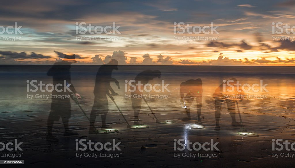 Multiple exposure of at treasure hunter with a metal detector stock photo