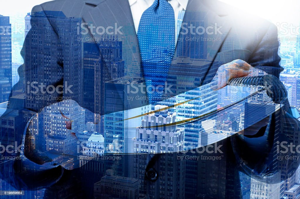 Multiple Exposure Of Businessman Handing Report To Viewer stock photo