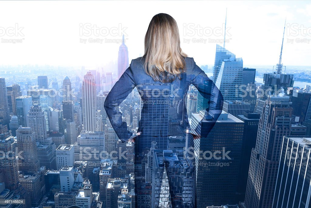 Multiple Exposure Of Businesswoman Looking Out At New York City stock photo