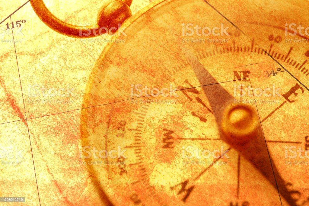 Multiple Exposure Of Compass And Antique Map stock photo